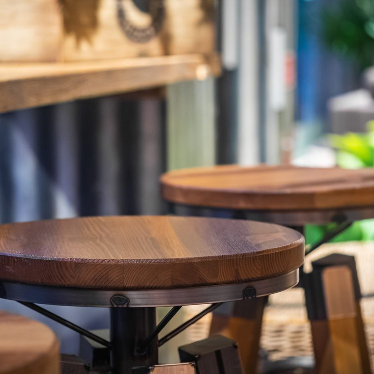 Picture of wooden round shaped chairs in coffee shop